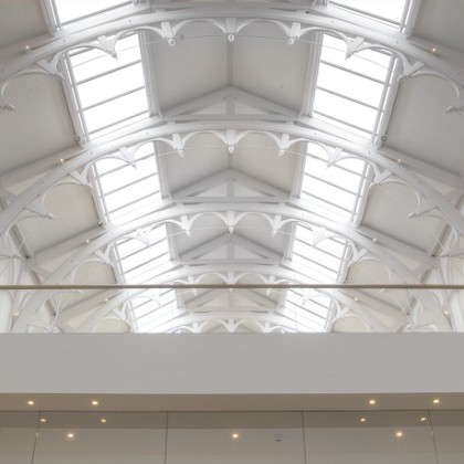 White structured roof with glass panels