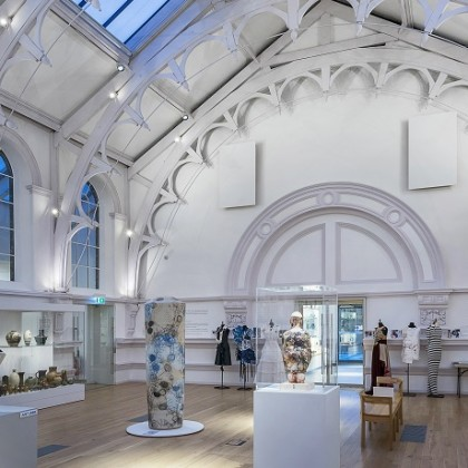 Interior gallery space with white Victorian vaulted ceiling