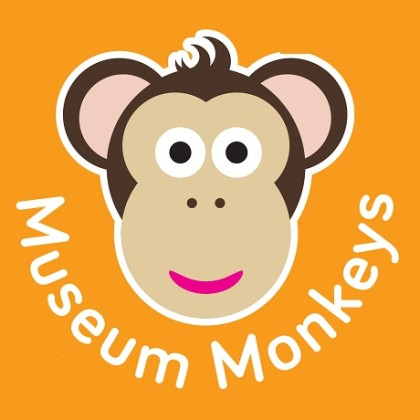Cartoon monkey face on orange background