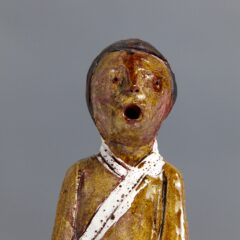 Ceramic man with wide mouth in scared expression