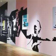 Graffiti-style dancers in black against pink wall