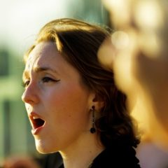 Close-up of woman's face singing