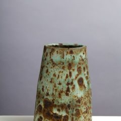 Abstract vase with green and brown mottled surface