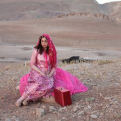 Photo of young woman in pink costume in a desert