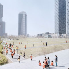Groups of adults and children walking through an open space, which is surrounded by skyscrapers.