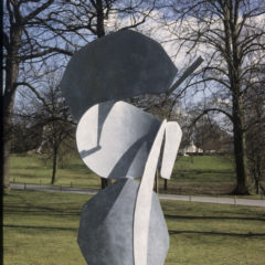 A grey sculpture in an outdoor space.