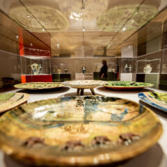 A visit stands in Grayson Perry exhibition and is surrounded by Grayson Perry ceramics.