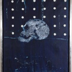 Black painting with a skull in the middle. The upper half of the work has a series of white dots. The work is framed in a silver border.